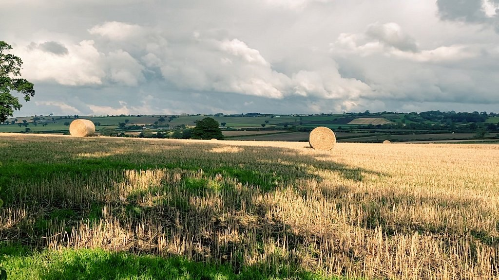 Hay-Bales-and-Stormy-Skies-Gilling-to-Easingwold-via-Yearsley.jpg