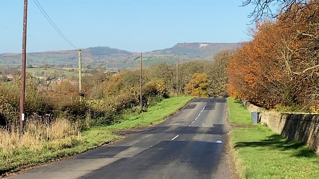 Road-to-Coxwold-with-the-White-Horse-in-view.jpg